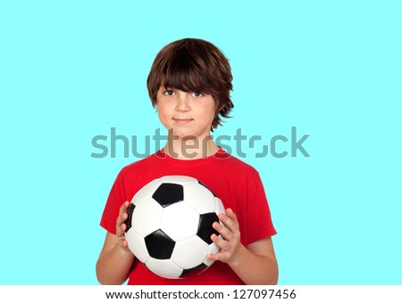 Adorable boy dreaming about being soccer player isolated on blue background - stock photo