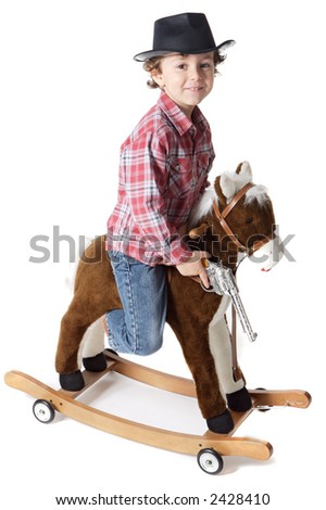 adorable boy playing cowboys with a wood horse a over white background