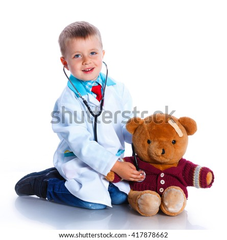 Adorable boy with clothes of doctor. Isolated on white background