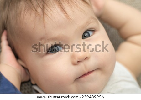 adorable caucasian baby girl portrait lying with hands up - stock photo