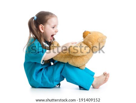 Adorable child dressed as doctor playing with toy over white - stock photo