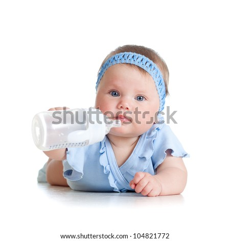 adorable child drinking from bottle. 8 months old girl. - stock photo