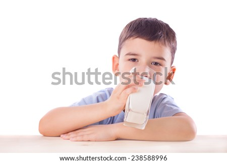 Adorable child drinks milk, isolated on white - stock photo