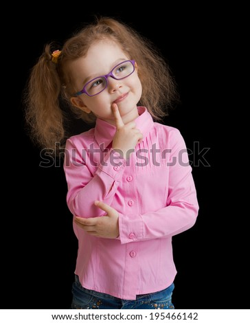 Adorable child girl in eyeglasses isolated on black - stock photo