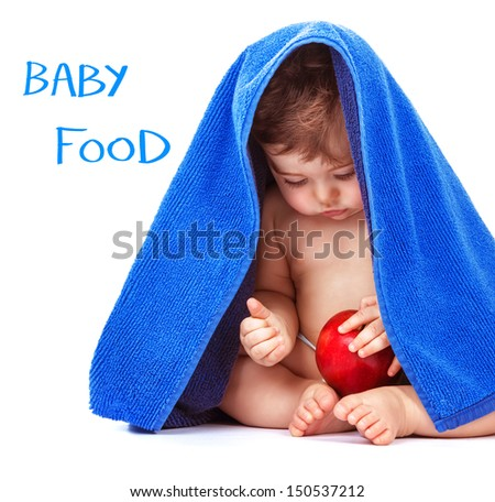 Adorable child sitting in the studio with red apple in hands and wrapped in blue towel, isolated on white background, little boy bathing, baby food concept  - stock photo