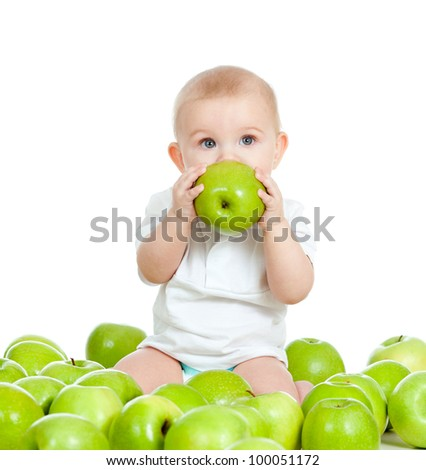 Adorable child with green apples - stock photo