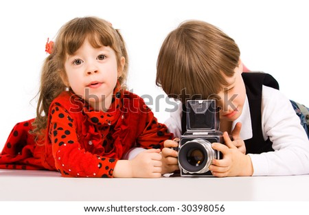 Adorable children taking pictures with photo camera