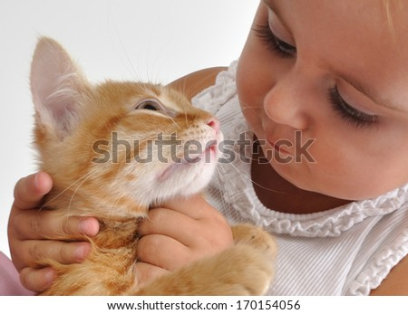 adorable cute baby child playing with a small kitten - stock photo