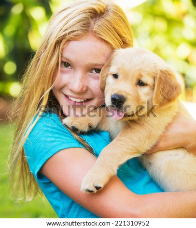 Adorable Cute Young Girl Playing and Hugging Puppies - stock photo