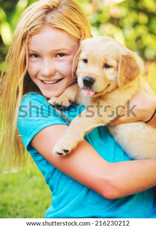 Adorable Cute Young Girl with Puppy - stock photo