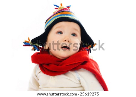 adorable displeased baby wearing warm winter clothes feels cold - stock photo