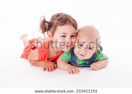 Adorable family. Sister and brother isolated on white - stock photo