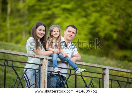 Adorable family together in the park - stock photo