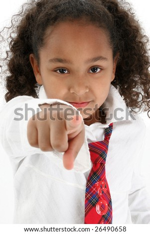 Adorable five year old African American Girl pointing.