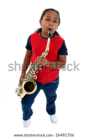 Adorable five year old black girl playing the saxophone over white. - stock photo