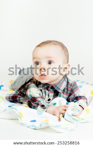Adorable funny baby with blue eyes. studio photo - stock photo