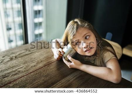 Adorable Girl Fun Curiosity Concept - stock photo