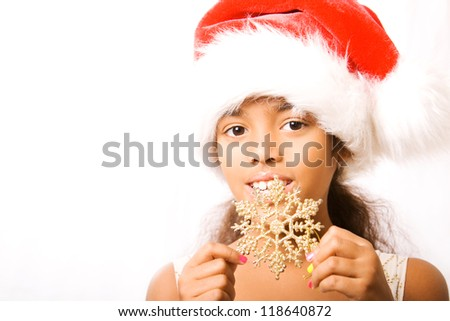 adorable girl in santa hat and dress - stock photo