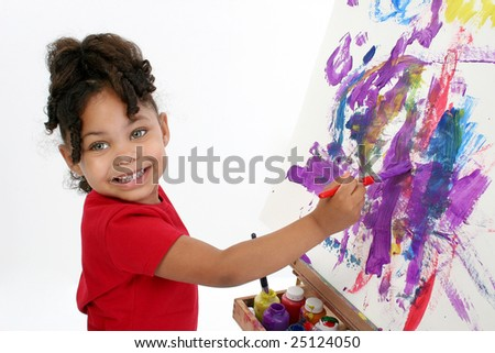 Adorable girl painting on easel over white. - stock photo