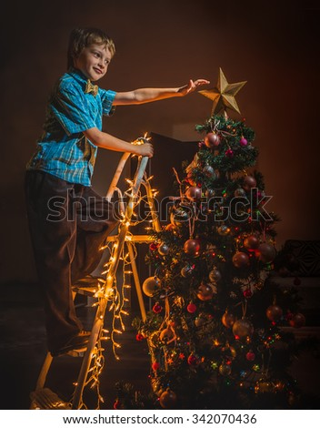 Adorable girl play with toy carriage and boy dressed Christmas tree - stock photo