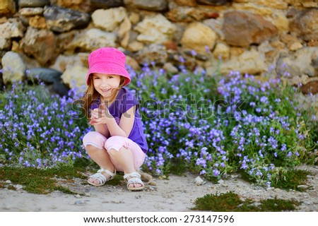 Adorable girl portrait outdoors at summer - stock photo