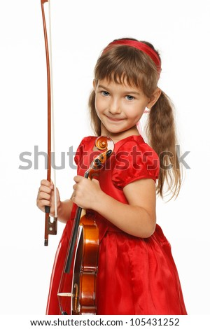 Adorable girl standing with violin, over white background - stock photo