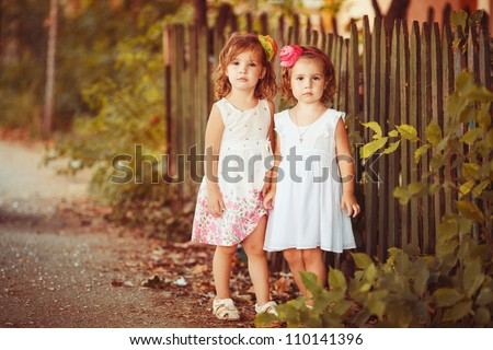 Adorable girls kids outdoors on summer day - stock photo
