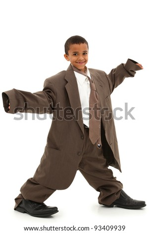 Adorable Handsome Black Boy Child in Baggy Business Suit laughing and walking over white background. - stock photo