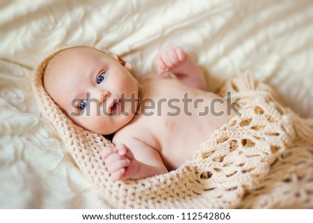 Adorable happy baby with towel - stock photo