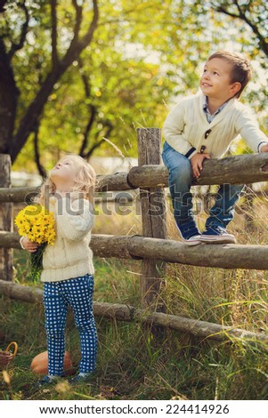 Adorable happy kids outdoors on sunny day - stock photo