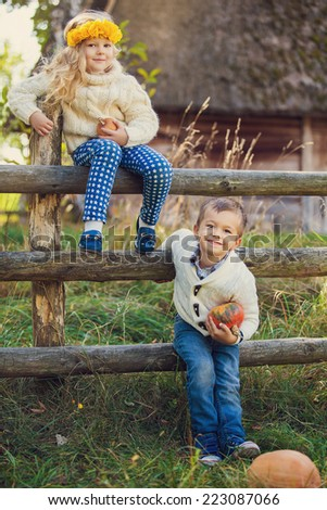 Adorable happy kids outdoors on sunny day. Cute young couple - stock photo