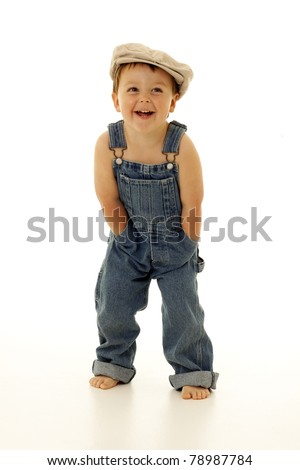 Adorable happy little boy in overalls - stock photo