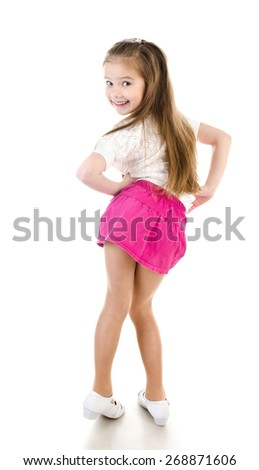 Adorable happy little girl posing back view isolated on a white - stock photo