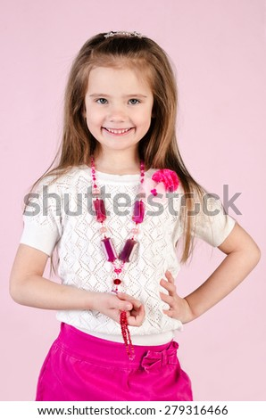 Adorable happy little girl posing with bag isolated  - stock photo