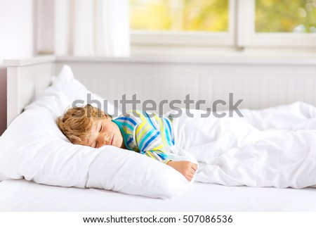 Happy little funny child colorful winter stock photo for Sleeping with window open in winter