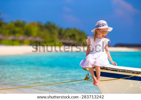 Adorable happy smiling little girl on boat in the sea - stock photo