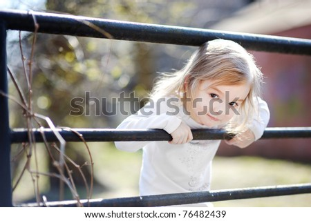 Adorable happy toddler girl smiling outdoors - stock photo