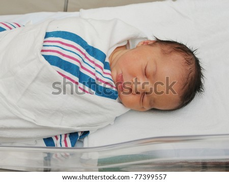 Adorable Healthy Newborn Infant Baby Sleeping in Acrylic Hospital Bassinet Just After Birth - stock photo