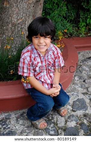 Adorable Hispanic boy smiling - stock photo