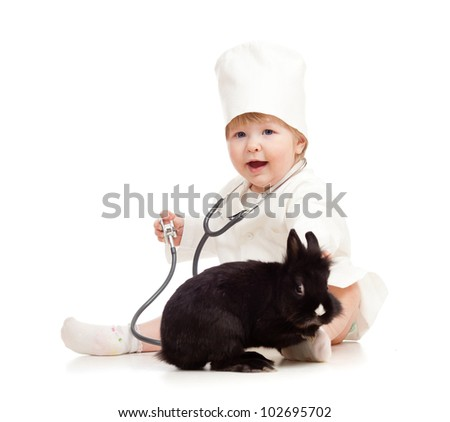 Adorable kid doctor with pet - stock photo