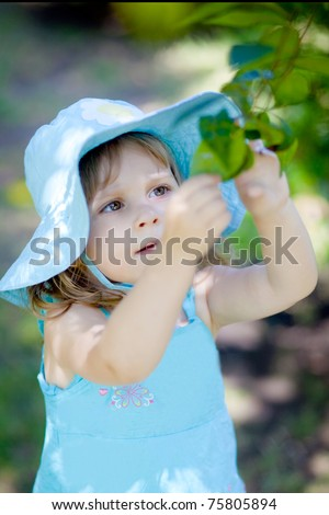 adorable kid girl interesting in nature - stock photo