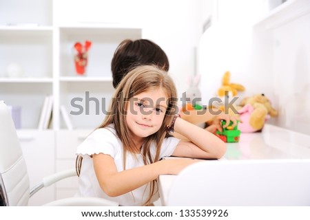 Adorable kids brother and sister at home in children room - stock photo
