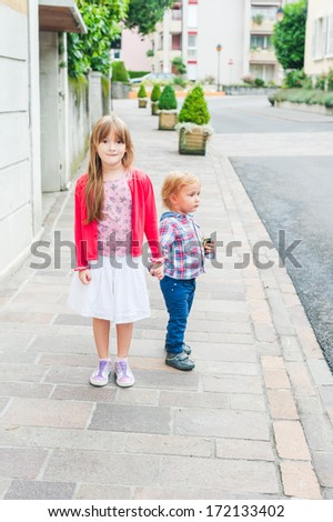 Adorable kids in a city on a nice day - stock photo