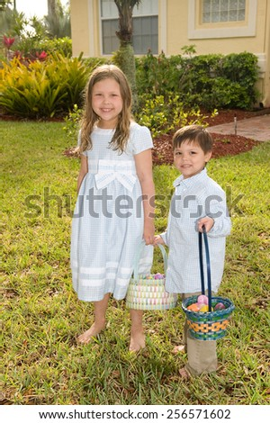Adorable kids outside with their Easter baskets - stock photo