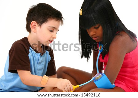 Adorable kids playing doctor and patient. - stock photo