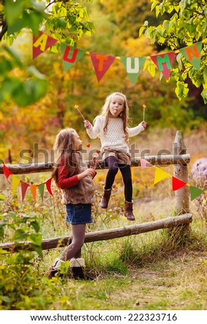 Adorable  kids playing in the park. Autumn concept - stock photo