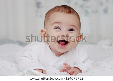 Adorable laughing baby boy - stock photo