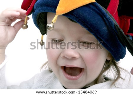 Adorable laughing baby in clown hat - stock photo