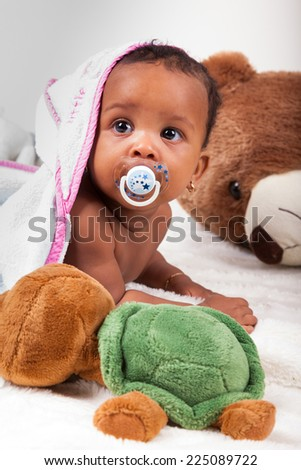 Adorable little african american baby girl  looking up - stock photo