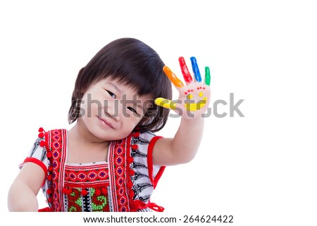 Adorable little asian (thai) girl painting her palm, colorful right hand painted with smiling face, happy childhood, some space for input text message. Isolated on white background, studio shot - stock photo
